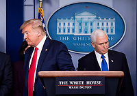 United States President Donald J. Trump, left, and US Vice President Mike Pence, right, depart after speaking on the COVID-19 (Coronavirus) pandemic during a Coronavirus Task Force briefing in the Brady Press Briefing Room at the White House in Washington, DC, March 18, 2020, in Washington, D.C. <br /> Credit: Kevin Dietsch / Pool via CNP/AdMedia