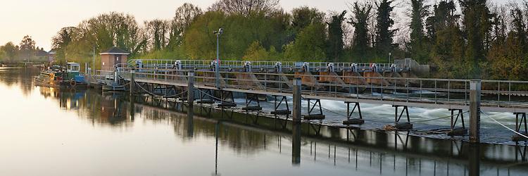 Weir at Bellweir Lock on the River Thames in Egham, Surrey, Uk