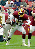 Landover, MD - December 23, 2001 -- Washington Redskins wide receiver Michael Westbrook (82) tries to run away from Chicago Bears defensive end Philip Daniels (93) during the game at FedEx Field in Landover, Maryland on December 23, 2001.  The Redskins lost the game 20 - 15.<br /> Credit: Arnie Sachs / CNP