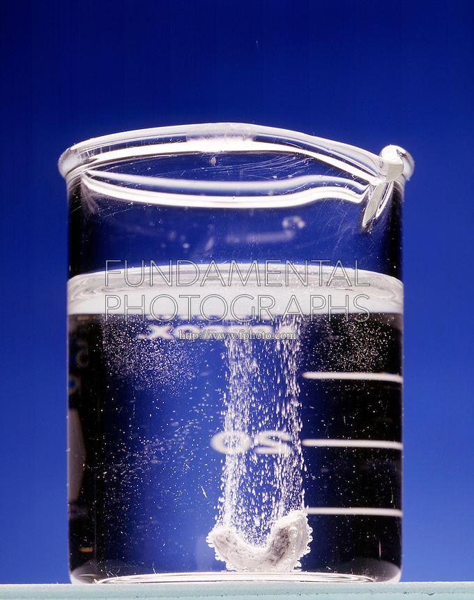 CALCIUM METAL REACTS SLOWLY WITH WATER<br /> Hydrogen Bubbles In Beaker Are Visible Result<br /> The alkaline-earth elements, except for beryllium, react with water to yield metal hydroxides.  The reactions are sluggish. Ca(s) + 2H2O(l) -&gt; 2CaOH(aq) + H2(g)