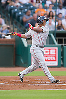 Rafael Devers (13) of the Greenville Drive follows through on his swing against the Greensboro Grasshoppers at NewBridge Bank Park on August 17, 2015 in Greensboro, North Carolina.  The Drive defeated the Grasshoppers 5-4 in 13 innings.  (Brian Westerholt/Four Seam Images)