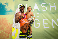 North Shore, Oahu, HAWAII - (Friday, Nov. 15, 2013) Sunny Garcia (HAW) the winner of the Clash of Legends with his grandson Sunny.--  The REEF Hawaiian Pro is the first stop of the $960,000 Vans Triple Crown of Surfing.<br /> The contest has until November 23 to run four full days of competition where 128 of the world's best surfers will compete for critical ASP Prime points and a share of $250,000 prize money. The winner of this event will take home $40,000 and an early lead on the 2013 Vans Triple Crown series ratings. <br /> <br /> A bad day turned good for 6-time Vans Triple Crown champion Sunny Garcia (HAW) today, bowing out of the main event but getting the better of a fun reunion with three other legends of the sport to win the exhibition REEF Clash of the Legends. The $10,000 first prize definitely helped to lift his mood. His former tour traveling partner Kaipo Jaquias (HAW) was second; Michael Ho (HAW) was third; and California's Brad Gerlach (USA) was fourth. This was Garcia's second &quot;Clash&quot; title.Photo: joliphotos.com