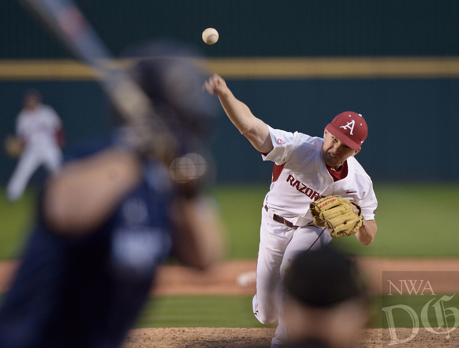 NWA Democrat-Gazette/BEN GOFF @NWABENGOFF<br /> Barrett Loseke of Arkansas pitches to a Rhode Island batter Friday, March 10, 2017, during the first game of a double header at Baum Stadium in Fayetteville.