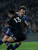 NZ's Anton Lienert-Brown tackles France's Maxime Medard during the Steinlager Series international rugby match between the New Zealand All Blacks and France at Eden Park in Auckland, New Zealand on Saturday, 9 June 2018. Photo: Dave Lintott / lintottphoto.co.nz