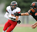 SIOUX FALLS, SD - SEPTEMBER 27:  Cam Holmes #2 from Brandon Valley tries to make a move past Max Sturdevant #32 from Washington in the first quarter of their game Friday night at Howard Wood Field. (Photo by Dave Eggen/Inertia)