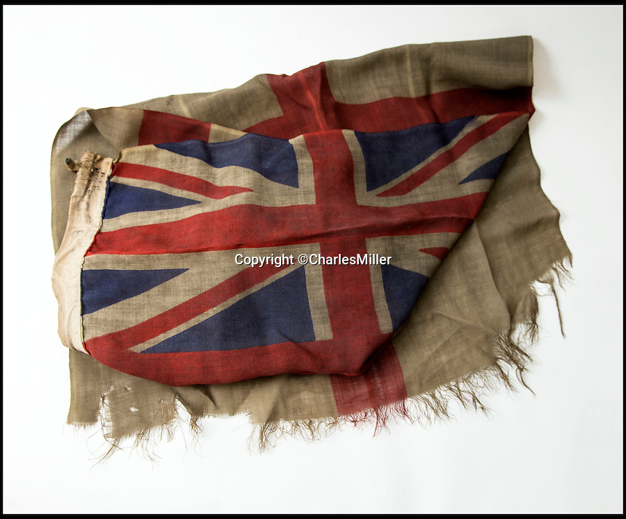 BNPS.co.uk (01202 558833)<br /> Pic: CharlesMiller/BNPS<br /> <br /> Remarkable survivor from the 'Longest Day'<br /> <br /> A smoke-stained and bullet-holed British flag that was the first raised on Sword Beach on D-Day has emerged for sale.<br /> <br /> Soldiers used the White Ensign to stake their claim on the Normandy beach during the historic invasion that changed the course of the Second World War.<br /> <br /> After it was hoisted, the 2.2ft by 4.4ft flag was clearly caught in the midst of battle as there are several bullet holes in it from where it had been shot by German fire.<br /> <br /> It is being sold for an estimated £3,000 at Charles Miller auctions of London.