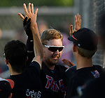 Triad starting pitcher Nick Beeler is congratulated by teammates after his fifth inning home run. Triad defeated Waterloo 4-2 in a Class 3A Baseball Regional semifinal baseball game on Thursday May 24, 2018. Tim Vizer | Special to STLhighschoolsports.com
