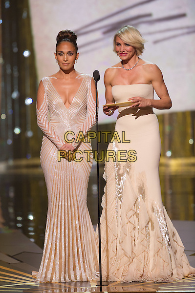 Jennifer Lopez and Cameron Diaz present at the 84th Annual Academy Awards® from Hollywood, CA February 26, 2012..*Editorial Use Only*.oscars full length stage dress white silver strapless .CAP/A.M.P.A.S./NFS.©A.M.P.A.S. Supplied by Capital Pictures.