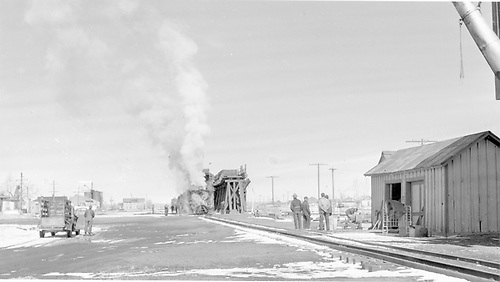 A distant view of D&amp;RGW rotary snowplow #OY taking coal at Antonito coaling trestle.<br /> D&amp;RGW  Antonito, CO  Taken by Richardson, Robert W. - 2/19/1952
