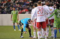 Referee Jair Marrufo sprays a line before a free kick. The New York Red Bulls defeated the Seattle Sounders 1-0 during a Major League Soccer (MLS) match at Red Bull Arena in Harrison, NJ, on March 19, 2011.