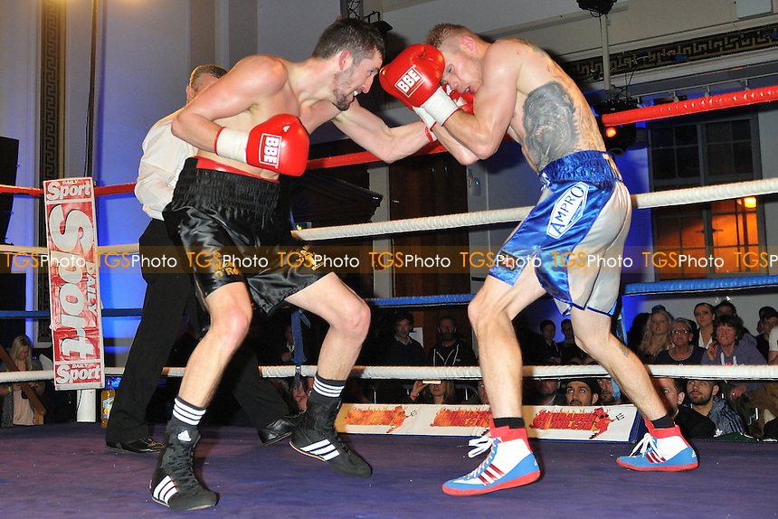 Michael O'Rourke (black shorts) defeats Andy Harris - Boxing at the Camden Centre, London - 07/02/15 - MANDATORY CREDIT: Philip Sharkey/TGSPHOTO - Self billing applies where appropriate - contact@tgsphoto.co.uk - NO UNPAID USE