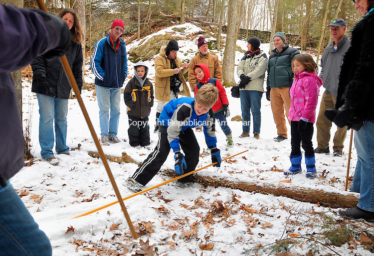 WASHINGTON, CT-13 FEBRUARY 2009-021310JS05-FOR COUNTRY LIFE-David Horne, 10, of Flamouth, Maine, left, tries his hand at the game snowsnake  Saturday during the Winter Games held at the Institute for American Indian Studies in Washington. The &quot;snakes&quot; were three to six feet long and carved from wood. The game was played by sliding the snakes down a track in the snow on a hill. The snake that went the farthest won.<br /> Jim Shannon Republican-American