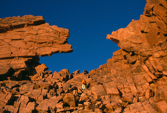 Hikers ascend to the Keyhole of Longs Peak in sunrise light, Rocky Mtn Nat'l Park, CO