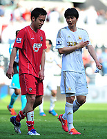 sport...swansea v southampton...liberty stadium...saturday 20th april 2013....<br /> <br /> <br /> Swansea's Ki Sung-Yeung talking with Maya Yoshida, leaving the pitch after drawing to Southampton 0-0