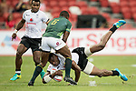 Siviwe Soyizwapi of South Africa (from back) tries to stop Sevuloni Mocenacagi of Fiji who runs with the ball during the match Fiji vs South Africa, Day 2 of the HSBC Singapore Rugby Sevens as part of the World Rugby HSBC World Rugby Sevens Series 2016-17 at the National Stadium on 16 April 2017 in Singapore. Photo by Victor Fraile / Power Sport Images