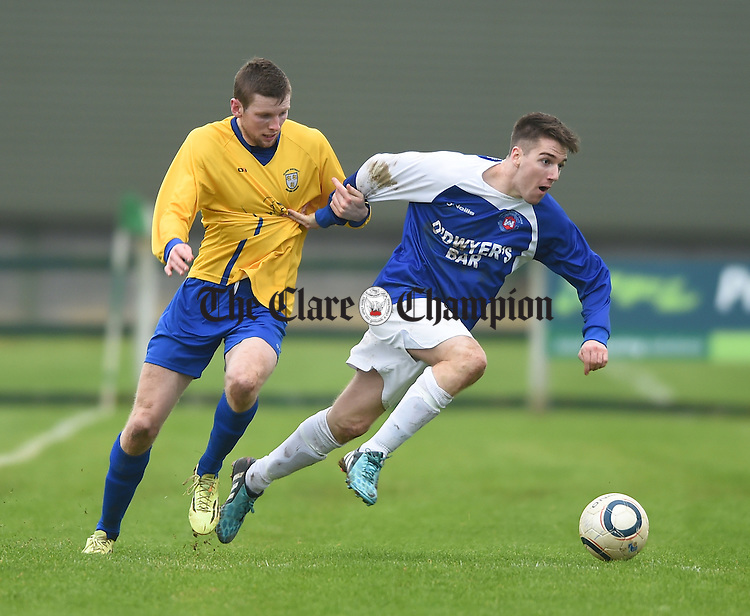 Colin Smyth of Clare in action against Johnathan Hannafin of Limerick during their FAI Oscar Traynor game in Limerick. Photograph by John Kelly.