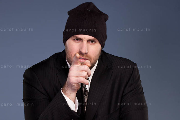 Man in ski cap pointing