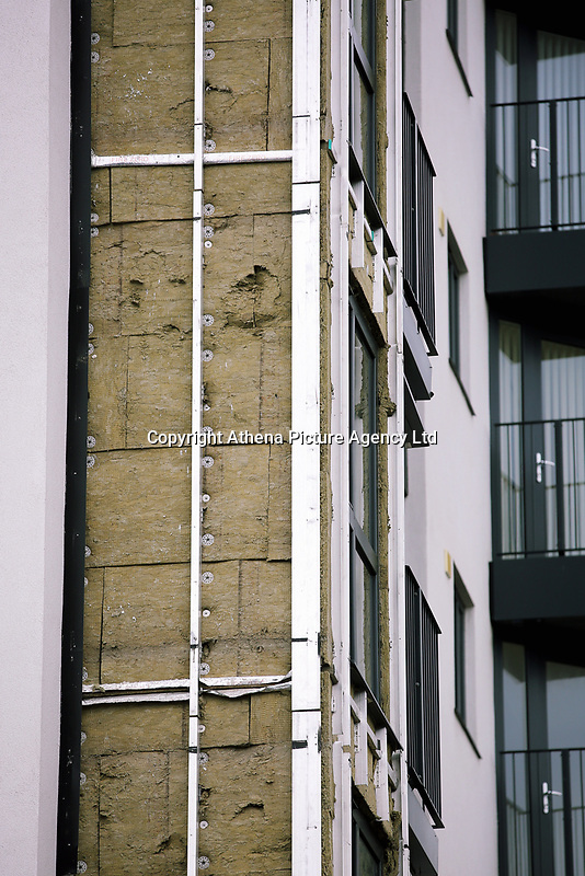Pictured: The exposed insulation after cladding panels were removed at Kennedy Gardens in Billingham. Tuesday 27 June 2017<br />Re: Cladding is being removed by workers from the fascia of high-rise flats at Kennedy Gardens in Billingham, County Durham, England, UK