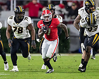 ATHENS, GA - NOVEMBER 09: D'Andre Swift #7 of the Georgia Bulldogs runs the ball during a game between Missouri Tigers and Georgia Bulldogs at Sanford Stadium on November 09, 2019 in Athens, Georgia.