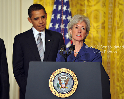 "Washington, D.C. - March 2, 2009 -- Governor Kathleen Sebelius (Democrat of Kansas), right, makes remarks after being named as Secretary of the Department of Health and Human Services (HHS) by United States President Barack Obama, left, in the East Room of the White House in Washington, DC on Monday, March 2, 2009.  The President also announced the release of $155 million authorized by the American Recovery and Reinvestment Act (ARRA) that will support 126 new health centers.  In a release, the White House stated ""These health centers will help people in need - many with no health insurance - obtain access to comprehensive primary and preventive health care services."".Credit: Ron Sachs / Pool via CNP"