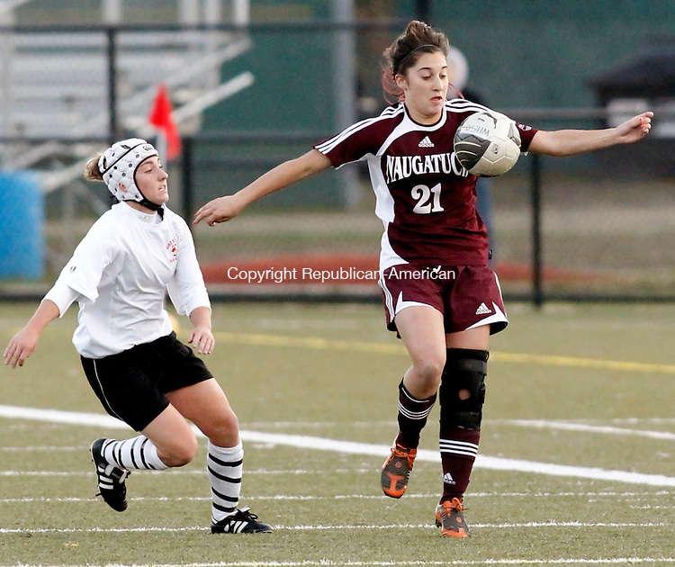Waterbury, CT- 03, November 2010-110310CM07 Naugatuck's Isabelle Moody controls the ball as Watertown's Jessica Spezzano (left) moves in to try and take control Wednesday night in Municipal Stadium. Watertown defeated Naugatuck for the NVL title, 2-1. Christopher Massa Republican-American