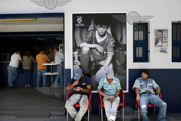 A bar, featuring a huge poster of footballer Cristiano Ronaldo as a child, at the Andorinha football club, Ronaldo's first team.