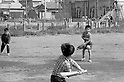 October 1964: Young boys playing baseball during the Showa period. (Photo by Katsuro Okazawa/AFLO)