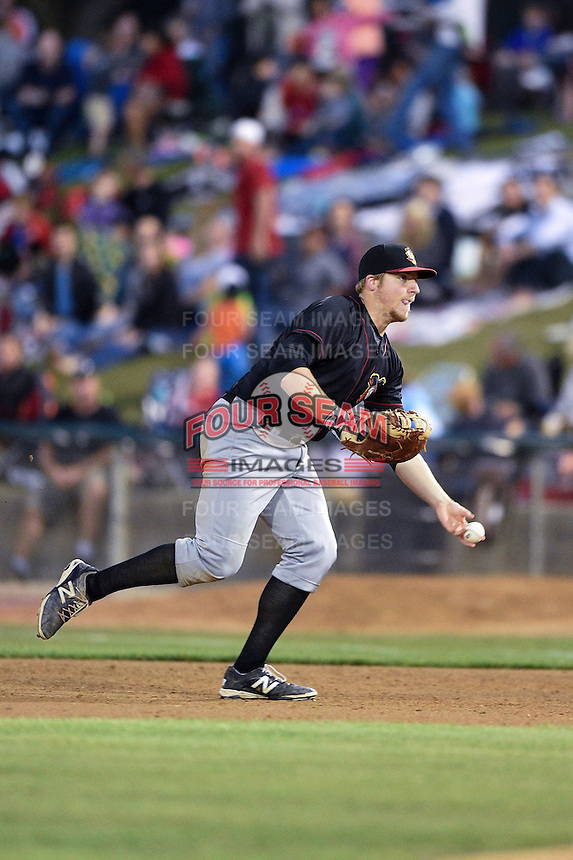 Quad Cities River Bandits first baseman A.J. Reed (18) flips the ball to the pitcher covering first during a game against the Kane County Cougars on August 14, 2014 at Third Bank Ballpark in Geneva, Illinois.  Kane County defeated Quad Cities 4-1.  (Mike Janes/Four Seam Images)