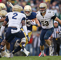 Cam McDaniel (33) carries the ball in the second quarter.