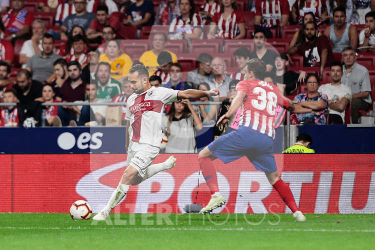 Atletico de Madrid's Carlos Isaac Munoz and SD Huesca's David Ferreiro during La Liga match between Atletico de Madrid and SD Huesca at Wanda Metropolitano Stadium in Madrid, Spain. September 25, 2018. (ALTERPHOTOS/A. Perez Meca)