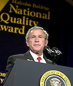 United States President George W. Bush makes remarks at the presentation ceremony for the 2003 recipients of the Malcolm Baldrige National Quality Award.  A record 7 companies were honored with the national award in quality and preformance excellence.  The Baldrige National Quality Program (BNQP) is a public-private partnership to improve the performance of United States organizations.  It manages the annual award that is named for former United States Secretary of Commerce Malcolm Baldrige.  Secretary Baldrige served under United States President Ronald Reagan.<br /> Credit: Ron Sachs / CNP