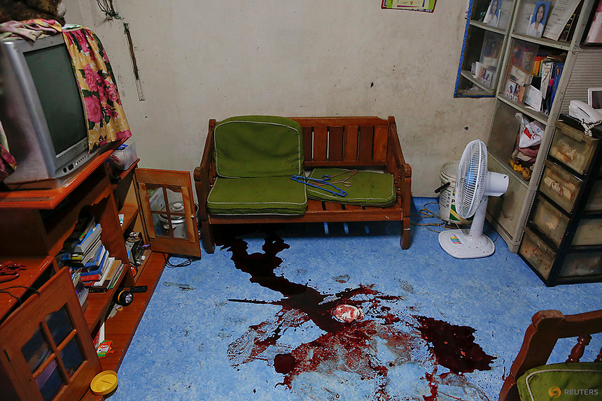 "Blood remains on the floor of a room where pedicab driver Norberto Maderal was killed by police who said he had pulled a gun and ""tried to open fire"" during a drug sting operation in Manila, Philippines October 19, 2016. REUTERS/Damir Sagolj"