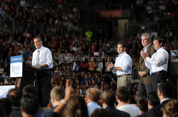 CORAL GABLES FL- OCTOBER 31:  Republican presidential candidate, former Massachusetts Gov. Mitt Romney speaks as Sen. Marco Rubio (R-FL), former Florida Gov. Jeb Bush and U.S. Representative Connie Mack attend a camapign rally at the University of Miami on October 31, 2012 in in Coral Gables, Florida. (Photo By Larry Marano (C)