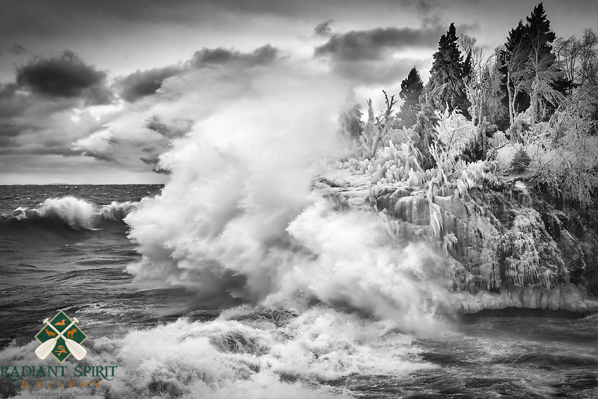 &quot;Winter's Final Act&quot;<br /> The wild waves and freezing spray painted winter along Lake Superior's North Shore. Photographing in these conditions can be challenging. In addition to maintaining stability in the strong winds, spray from huge waves pelts us and our gear, freezing within seconds. Yet, we eagerly head to her shores to witness her power and fury.