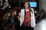 A model walks the runway at a fundraiser for Deck My Room at Tootsies Tuesday  Feb. 12, 2013.(Dave Rossman/ For the Chronicle)