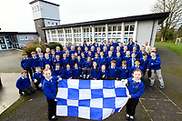 30-11-2017: Twins, Shona and Danielle Fitzpatrick (6) hold the blue &amp; white flag at Knocknagree National School while supporting their team against Dromid of Kerry in the Munster Football Final on Sunday. Also in picture are teachers Maura Daly, Clare Jones, Aisling Riordan, Nicola O'Donoghue and DJ Golden.<br /> Photo: Don MacMonagle