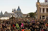 Massive crowds near Piazza San Marco during the Venice Carnival (Carnevale di Venezia), Venice, Italy.