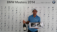 Edoardo Molinari (ITA) holds his prize for his hole in one at the 4th hole during Thursday's Round 1 of the 2014 BMW Masters held at Lake Malaren, Shanghai, China 30th October 2014.<br /> Picture: Bernie Maguire www.golffile.ie