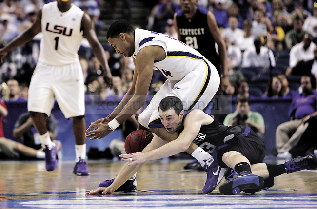 Michael Porter lunges for the ball. Porter made three 3-point baskets in the Cats' loss to the Tigers. Photo by Brad Luttrell | Staff...