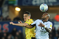 Shaun Williams of Millwall battles with Andre Ayew of Swansea City during the Sky Bet Championship match between Swansea City and Millwall at the Liberty Stadium in Swansea, Wales, UK. Saturday 23rd November 2019