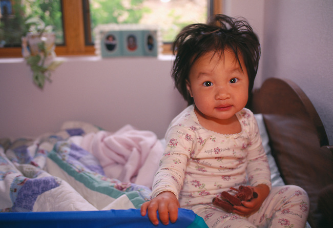 Young Asian girl who just awakened, Estes Park, CO