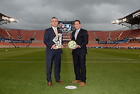 Houston Texas - Jeff Plush (left) NWSL Commissioner and Chris Canetti, President of the Houston Dash pose for a photo with the NWSL trophy prior to the Houston Dash versus Chicago Red Stars game on Saturday, April 16, 2016 at BBVA Compass Stadium in Houston Texas.  The Houston Dash defeated the Chicago Red Stars 3-1.