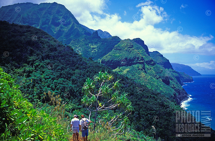 Hikers see the Na Pali Coastline along the Kalalau Trail, Kauai
