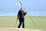 BROWNS SUMMIT, NC - APRIL 02: Notre Dame's Jordan Ferreira holds the flag on the 14th green. The third round of the Bryan National Collegiate Women's Golf Tournament was held on April 2, 2017, at the Bryan Park Champions Course in Browns Summit, NC.