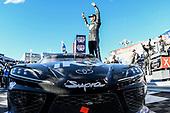 #18: Kyle Busch, Joe Gibbs Racing, Toyota Supra Extreme Concepts/iK9, celebrates after winning.