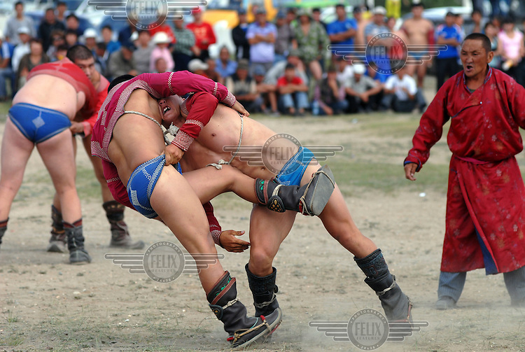 A khuresh wrestling competition at festivities for the Tuvan Naadym (New Year) holiday in Erzin.
