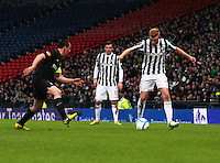 Conor Newton takes on Scott Brown as Graham Carey watches in the St Mirren v Celtic Scottish Communities League Cup Semi Final match played at Hampden Park, Glasgow on 27.1.13.