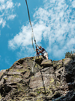 A slackliner tightens and secures a slackline for a highline walk at North Tale Mountain in Golden, Colorado, Tuesday, August 29, 2017. The Adventurist columnist Clint Carter took on a vertigo-inducing highline&nbsp;that stretches across a traverse after only 4 days of training.<br /> <br /> Photo by Matt Nager