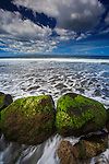 Rocks exposed at low tide on the western coast of Bali, Indonesia