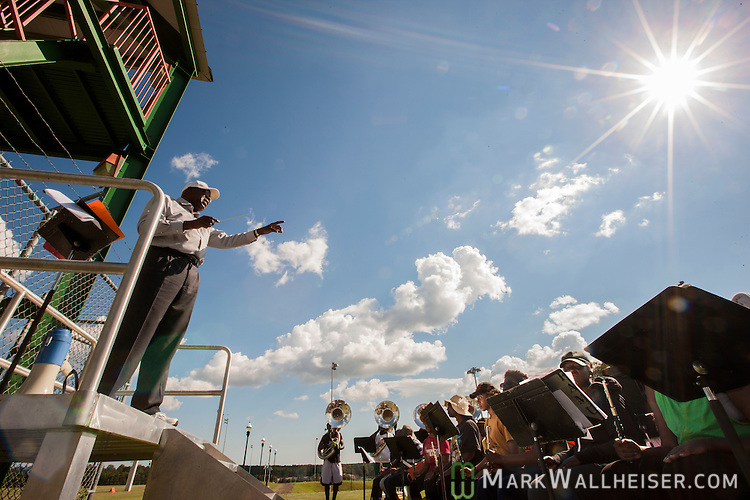 TALLAHASSEE, FL - SEPTEMBER 5, 2013:   Dr. Sylvester Young, director of marching and pep bands, leads the band during the FAMU Marching 100 band practice on the Florida A&M University campus.